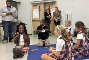 WINGS students interacting with other children